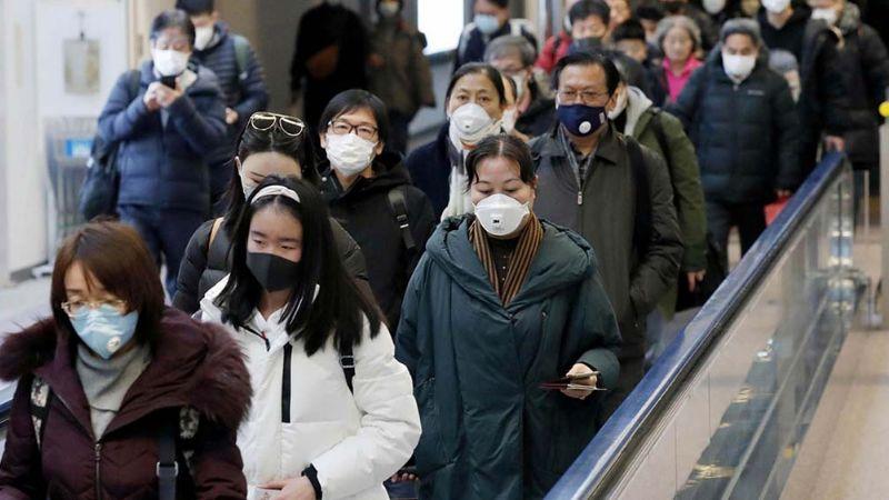 Entre gritos de aliento, Wuhan muestra su optimismo frente al coronavirus
