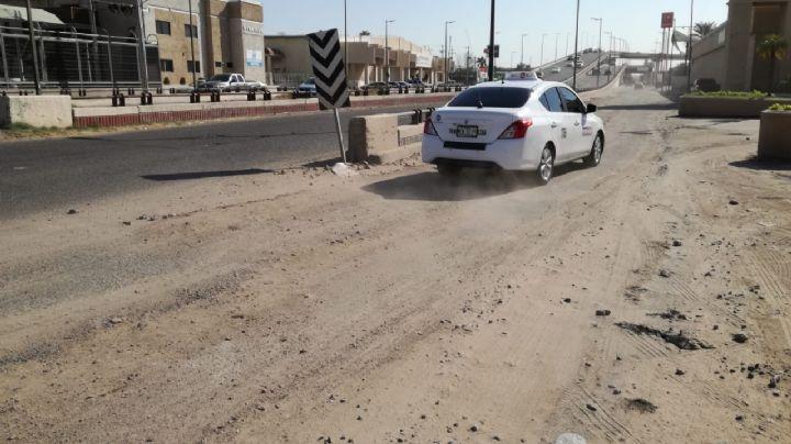 Le sacan la vuelta a los baches en calles de Hermosillo para evitar accidentes