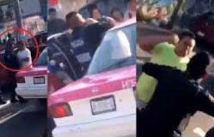 """(VIDEO) Captan pelea entre taxistas y policías: """"A huevo poli, dele en su ma..."""""""