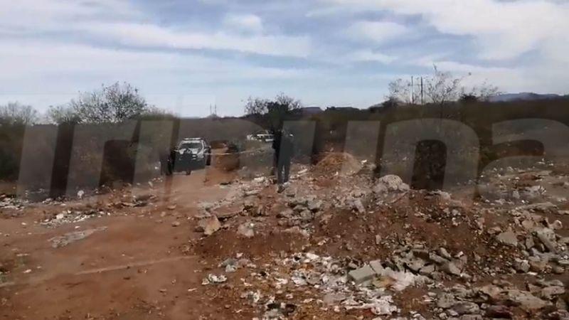 Autoridades localizan el cuerpo de un menor y una mujer en un baldío