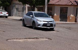 AMLO dará apoyo para bacheo; 70% de las calles en Cajeme están dañadas