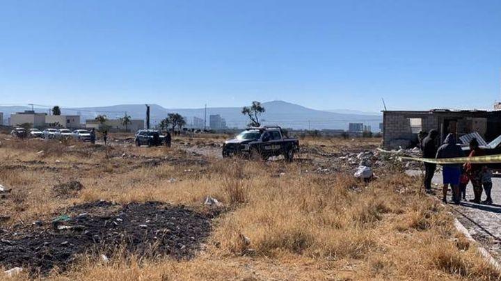 Hallan a mujer muerta en predio de Querétaro; primer feminicidio del 2021
