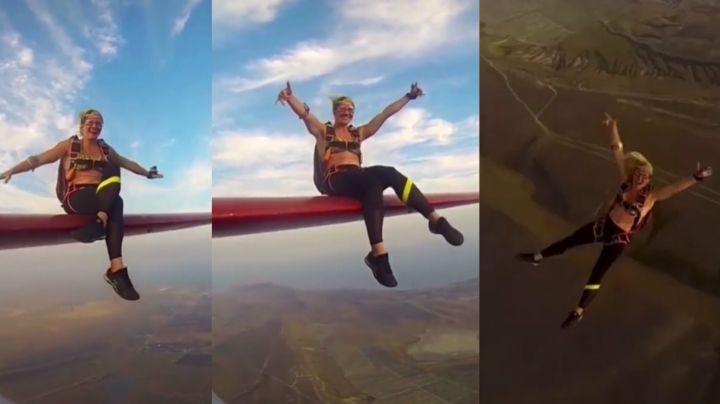 VIDEO: Mujer pasea sobre el ala de una avioneta y se lanza con paracaídas