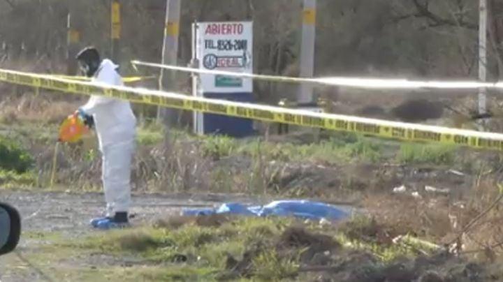 Gatilleros ejecutan a un hombre y dejan su cuerpo en una estación de gas