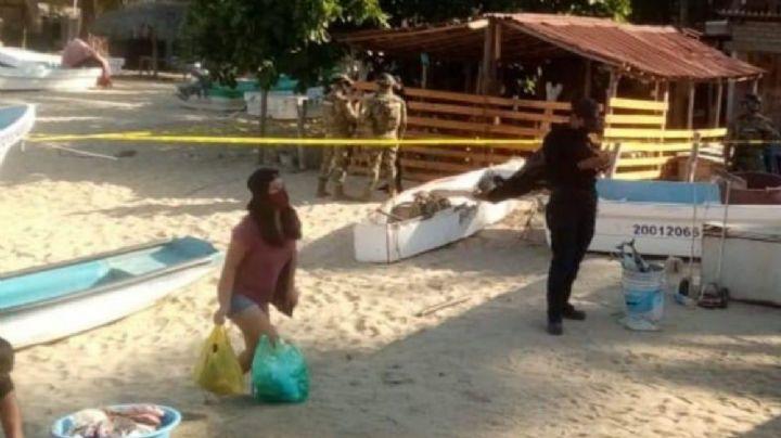 ¡Trágico! Asesinan a hombre en playa turística de Oaxaca; hallan su cuerpo en una lancha