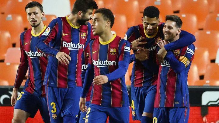 El Barcelona vence al Valencia y mantiene con vida sus ilusiones de levantar el título