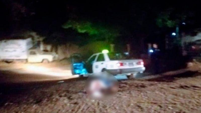 Ejecutan a taxista en Cajeme; su cuerpo quedó tendido a un lado de su unidad