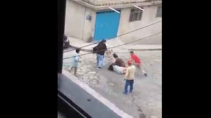 VIDEO: Familias se enfrentan a 'machetazos'; una mujer resulta lesionada