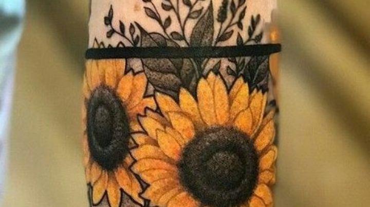 Demuestra tu fortaleza con estos tatuajes para hombres en el brazo de flores de girasol