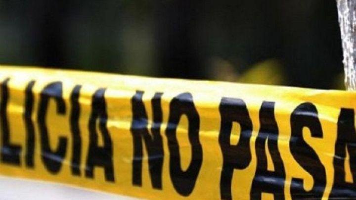 FUERTES IMÁGENES: Hallan a un cadáver en una gasolinera; murió de un balazo en la cabeza