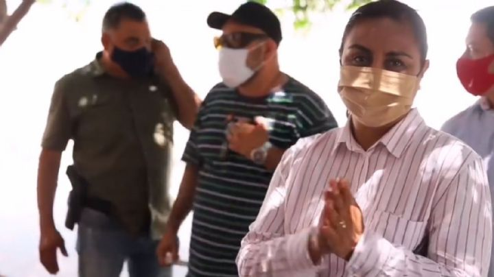 La candidata Griselda Martínez Martínez llega a votar rodeada de un anillo de seguridad