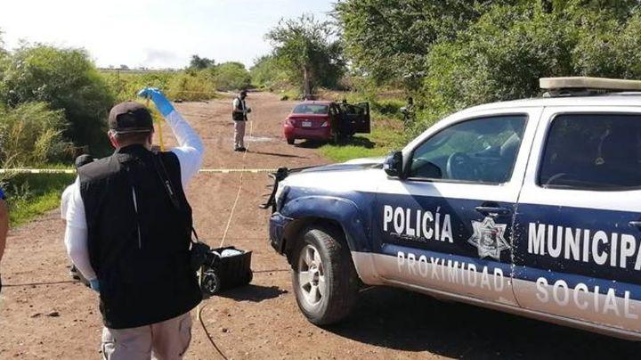 Caos en Culiacán: Con múltiples impactos de bala, localizan el cuerpo de un hombre dentro de un auto